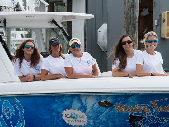 Jaime Buffington (far left) poses with Women's Offshore