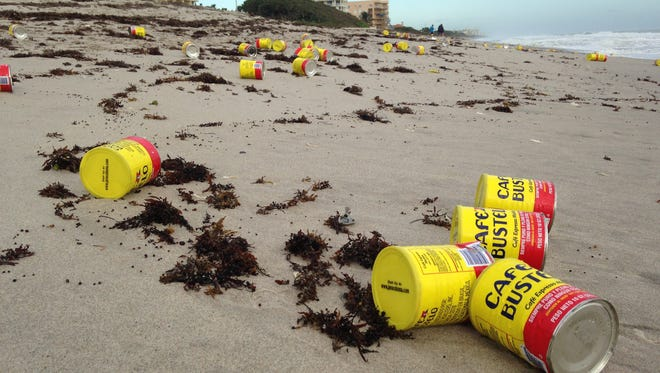 Bustelo coffee cans dot the landscape for miles in Indialantic Tuesday morning after washing ashore overnight