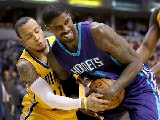 Indiana Pacers guard Monta Ellis (11) attempts to rip the ball from Charlotte Hornets forward Marvin Williams (2) in the second half of their game Wednesday, Feb 10, 2016, evening at Bankers Life Fieldhouse. The Charlotte Hornets defeated the Indiana Pacers 117-95.