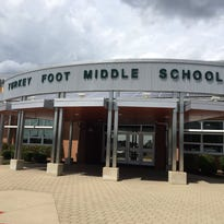 Officials: Employee brought loaded gun to Turkey Foot Middle School