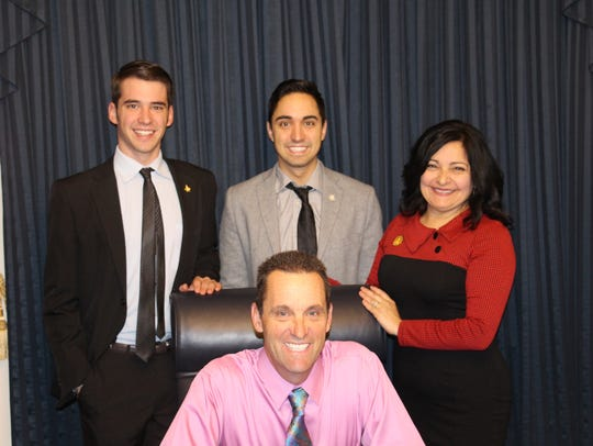 U.S. Rep. Steve Knight, center, poses for a photo with