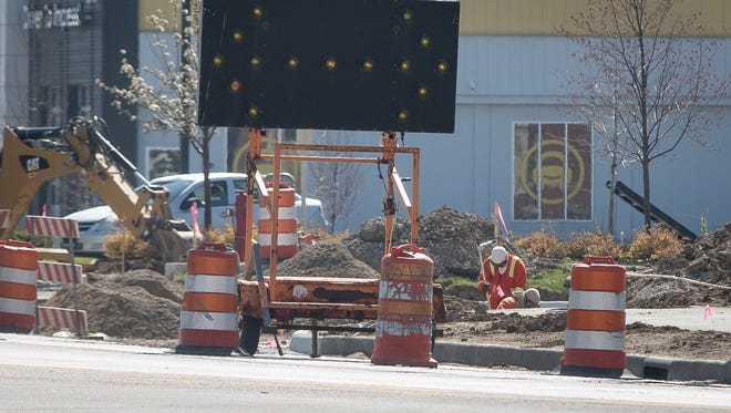 Vectern crews work near a section of West McGalliard Road between Walnut and Reserve Streets Thursday morning for a gas leak near the Crew Car Wash. The road was closed for nearly five hours.