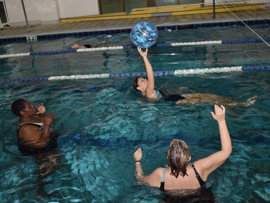 Brandi Bell (center, back), a personal trainer at the Louisiana Athletic Club in Pineville and the instructor for the water volleyball class, plays with participants Priscilla Vinson (left) and Sally Cooper (right) in the lap pool at the Louisiana Athletic Club in Pineville. The class plays at 8 a.m. on Wednesdays. On the last Friday of each month, a two-hour tournament is held. The class is more about fun and socialization than competition.