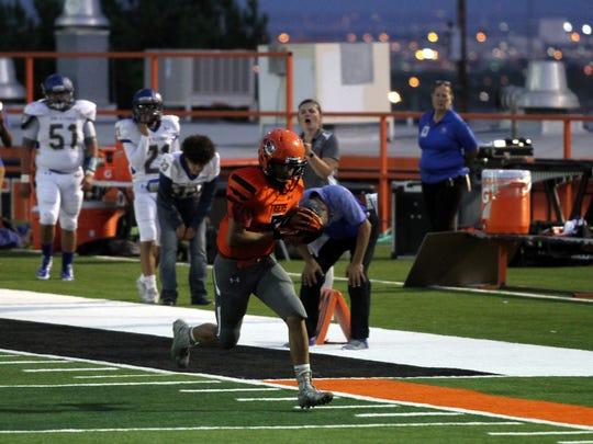 El Paso High School receiver Johny Avila races for the end zone against San Elizario Friday night at Jones Stadium.