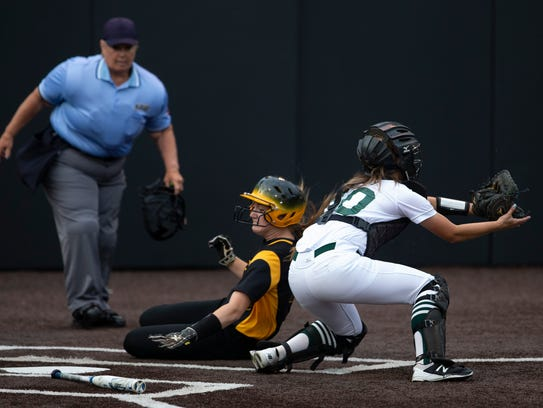 St John Vianney's Haley Ahr slides into home for her team's second run of the game versus Steinert, the  NJSIAA Tournament of Champions State semifinal at Seton Hall University in South Orange on Wednesday.