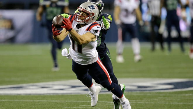 New England Patriots wide receiver Julian Edelman makes a diving catch in front of Seattle Seahawks strong safety Jamal Adams during the second half of an NFL football game, Sunday, Sept. 20, 2020, in Seattle.