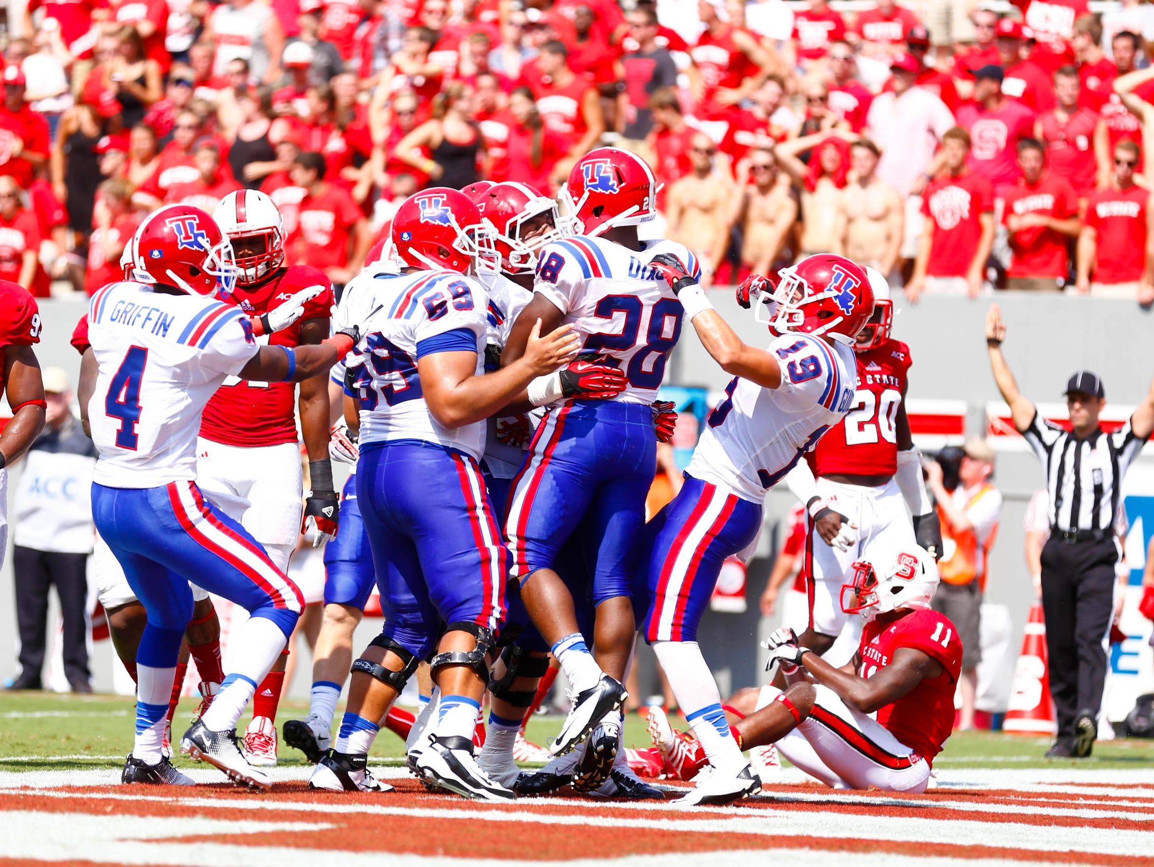 Louisiana Tech running back Kenneth Dixon (28) celebrates