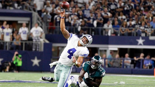Dallas Cowboys quarterback Dak Prescott (4) is hit as he throws a pass by Philadelphia Eagles strong safety Malcolm Jenkins (27) in the fourth quarter at AT&T Stadium.