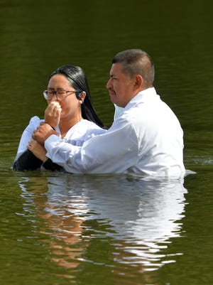 WORCESTER - Atilio Vasquez of Iglesia Cristiana Bet-El, 5 Wiser Ave., immerses Michelle Chiem in Coes Pond on Sunday, September 13, 2020, during her baptism.
