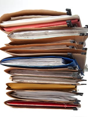 Computerization helps but doesn't eliminate paper clutter on financial, tax accounts.