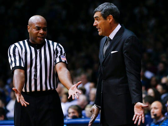 Referee Jeff Anderson, a 1985 Franklin High graduate, runs with the elite in college basketball. Herehe explains a call to Villanova coach Jay Wright during a 2013 game at Butler.