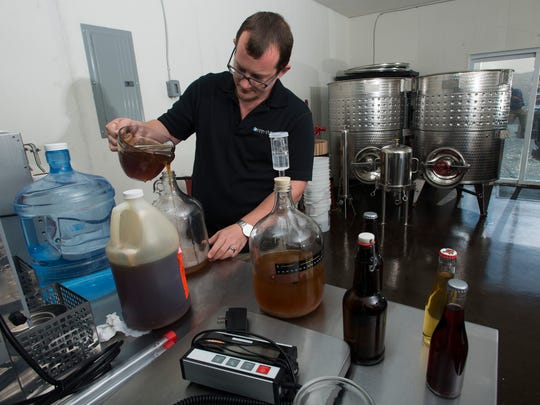 Pensacola resident John Wilson begins the brewing process for a new batch of mead on April 19, 2017. Wilson has perfected his brewing process of the honey wine and is planning to open a new mead brewery Nine Mile Road in early July.