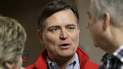 Congressman Luke Messer talks with supporters at the