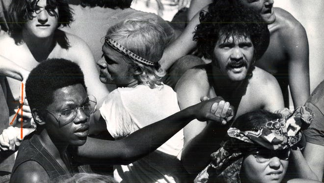 """The original published newspaper caption on this photo from the 1970 Wadena rock fest: """"Black and white groove together to the red-hot music."""""""