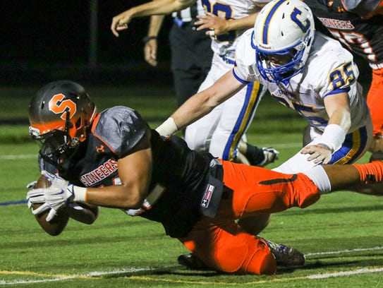 Somerville's Hamza Akel (52) recovers a blocked punt