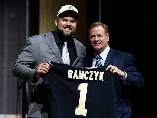 Wisconsin's Ryan Ramczyk, left, poses with NFL commissioner Roger Goodell after being selected by the New Orleans Saints during the first round of the NFL football draft Thursday.