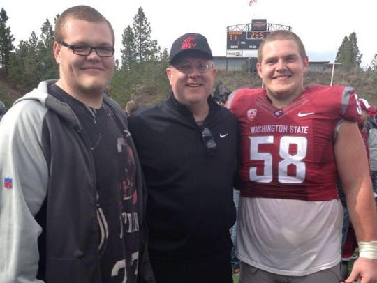 Riley Sorenson, right, stands with father Bart Sorenson