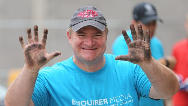 Enquirer Media Publisher Rick Green works at the Fisher House Saturday morning as part of Make a Difference Day.