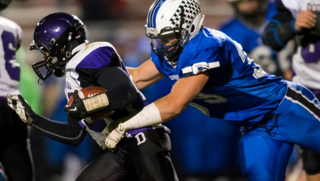 St. Mary Springs' Clay Schueffner comes from behind on a tackle on Dodgeland's Matt Moynihan on Friday at Oriole Sports Complex in North Fond du Lac during the WIAA Level 2 Division 6 playoff game October 27, 2017.