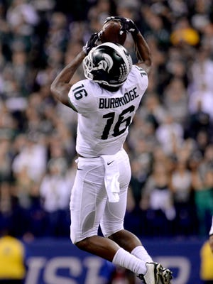 Receiver Aaron Burbridge goes airborne to catch a Connor Cook pass Dec. 5 in Indianapolis during MSU's 16-13 win over Iowa in the Big Ten Championship football game.