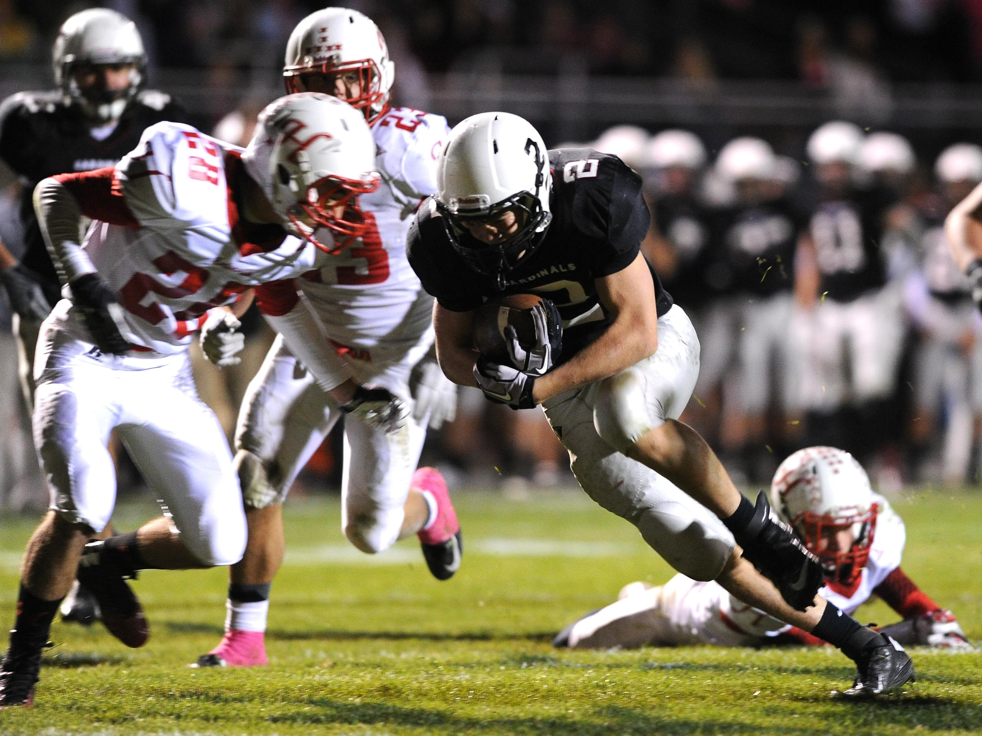 Fond du Lac's Justin Maratik runs with the ball in a game last year. Maratik will be a key piece for the Cardinals in 2015.