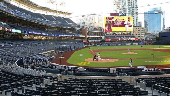 Arizona Diamondbacks starting pitcher Madison Bumgarner (40) throws to San Diego Padres Manny Machado in the first inning on Opening Day.