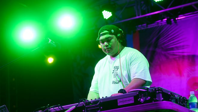 DJ Sylnt showcases his turntable skills during the Guam Summer Beach Fest in Tumon on Aug. 13.