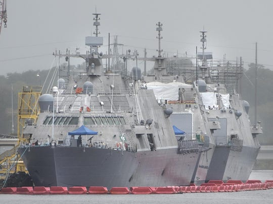 The USS Detroit, nearest, is seen at the Fincantieri Marinette Marine shipyard Tuesday.