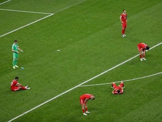 Russian players deject at the end of the Confederations Cup, Group A soccer match between Mexico and Russia, at the Kazan Arena, Russia, Saturday, June 24, 2017. Mexico won 2-1. (AP Photo/Sergei Grits)