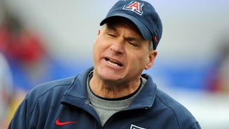 Dec 19, 2015; Albuquerque, NM, USA; Arizona Wildcats head coach Rich Rodriguez reacts during the second half against the New Mexico Lobos in the 2015 New Mexico Bowl at University Stadium. Mandatory Credit: Matt Kartozian-USA TODAY Sports