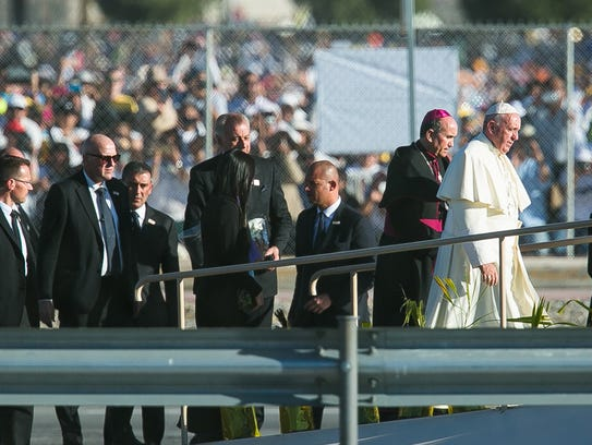 The pope walks up a ramp on Wednesday where he blessed
