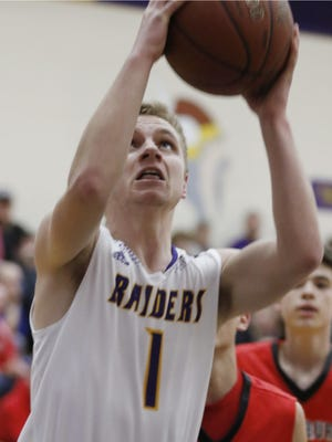 Two Rivers' Trevor Smith (1) goes for the hoop during the first half of the WIAA Division 3 regional quarter final game against Oostburg on Tuesday, March 1 in Two Rivers.