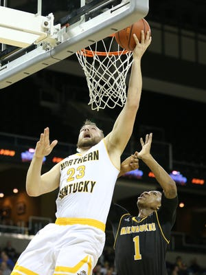Northern Kentucky Norse forward Carson Williams (23) scores on Milwaukee Panthers guard Jeremiah Bell (1) in the second half during the NCAA basketball game between the Milwaukee Panthers and the Northern Kentucky Norse, Thursday, Feb. 8, 2018, at BB&T Arena in Highland Heights, Ky.