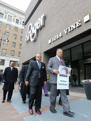 The Rev. Jesse Jackson leads a protest outside Cincinnati-based Kroger headquarters downtown, Tuesday, April 10, 2018 in Cincinnati. Jackson called for a boycott of Kroger in response to closing stores in Memphis and other communities that had served minority communities, including Walnut Hills.