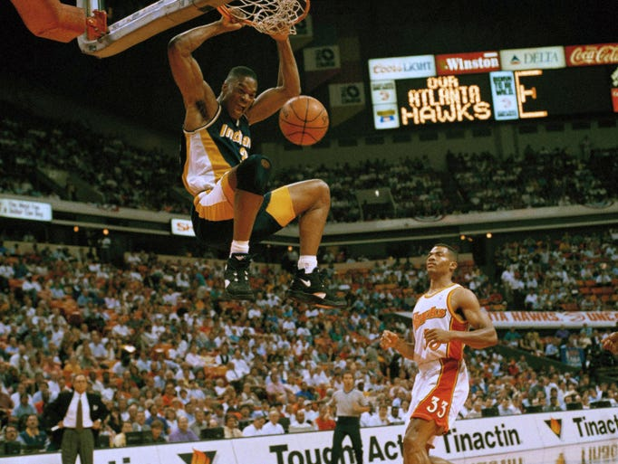 Pacers Antonio Davis (33) puts away two points as Atlanta Hawks Duane Ferrell (33) looks on during first half play of the Eastern Conference semifinals at The Omni, May 17, 1994, Atlanta, Ga.