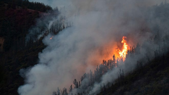 Flames from the Ferguson Fire burn down a hillside in unincorporated Mariposa County Calif., near Yosemite National Park on July 15, 2018.