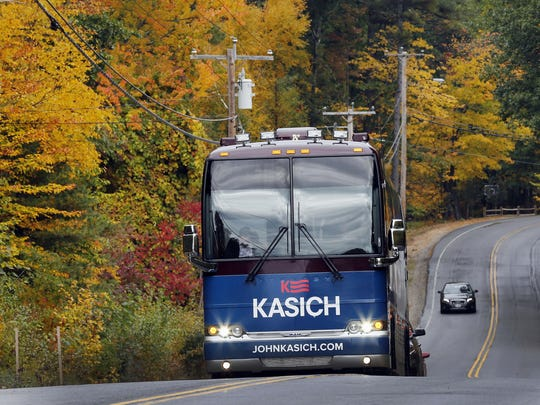 Kasich rides through the fall colors in his bus on