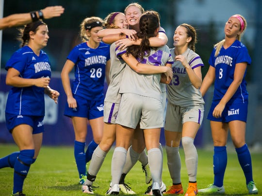 Indiana State defenders watch as Evansville's Mikayla Harvey (12) from left, celebrates her goal with teammates Sara Osinski (3) Colleen Dierkes (24) Montana Portenier (13) during their game against Indiana State at Arad McCutchan Stadium in Evansville, Wednesday, Oct. 19, 2016.