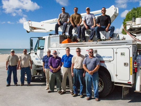 Staff of Two Rivers Water and Light's electric crew