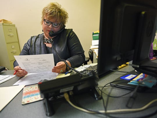 Kelli Peterson, a victim witness assistant with the Minnehaha County State's Attorney's office, speaks to a victim of a crime over the phone Thursday, Oct. 6, 2016, in the Minnehaha County Administration building in Sioux Falls.