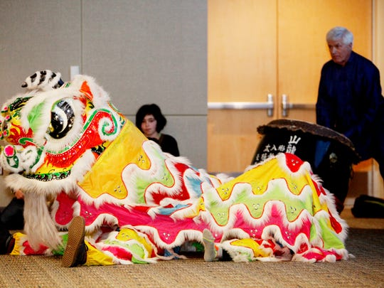 The Lion Dance is performed during UNCA's celebration of the Chinese New Year January 17, 2017, as Mark Small, right, plays a drum