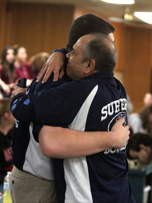 Suffern's Tom Chamberlain is congratulated by coach Bill Gonzalez after he bowled a perfect 300 game at the Section 1 boys bowling tournament at Fishkill Bowl Feb. 7, 2017. He scored 297 on his next game.