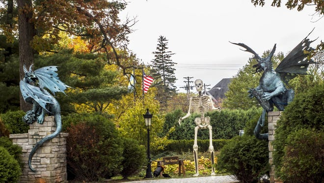 A large skeleton looms over the entrance to Carl Soderstrom's annual Halloween event on Grandview Drive in Peoria Heights.