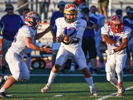 Mount Shasta quarterback Thairen Sivongsa hands off