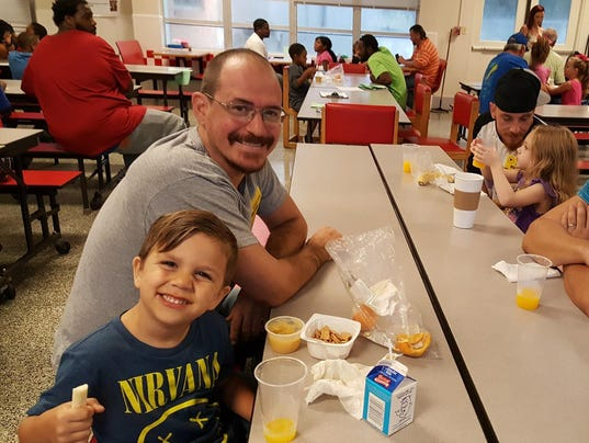 636138976415125025-west-pensacola-elementary-donuts-with-dad-.jpg