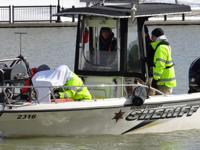 Scuba team members on a Monroe County Sheriff's boat