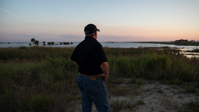 Jeff Leserra, a Fellsmere sportsman who manufactures gear for the outdoors industry, looks out over the 10,000-acre reservoir at the Fellsmere Water Management Area on Dec. 20, 2017, in Indian River County. Since breaking ground nearly a decade ago, the project — created to hold stormwater runoff and restore the headwaters of the St. Johns River — has cost taxpayers $53 million, and lacks a much-needed boat ramp, he said.