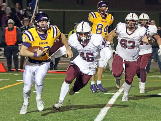 Johnston junior quarterback Andrew Nord (10) runs