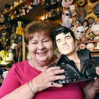 Marge Nierengarten points out some of her favorite heads in her collection of about 3,000 heads.