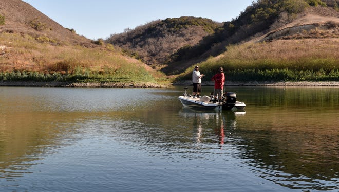 Nathan Decker, right, and Louis Ordonez, of Oak View, fish in a quiet area of Lake Casitas on Oct. 19.